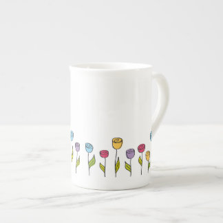 Stylized flowers in various colors tea cup