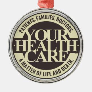 Su atención sanitaria adorno redondo plateado