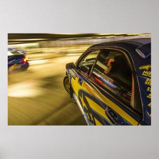 Subaru's racing in an underground car park poster