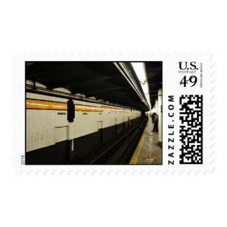 Subway tunnel with tile wall postage stamp
