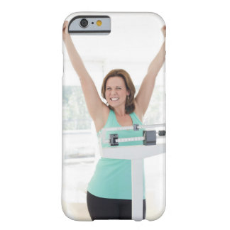 Successful weight loss. Happy woman weighing Barely There iPhone 6 Case