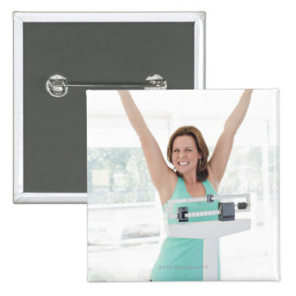Successful weight loss. Happy woman weighing Pinback Buttons