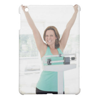 Successful weight loss. Happy woman weighing Cover For The iPad Mini