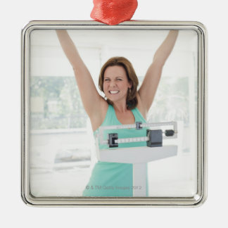 Successful weight loss. Happy woman weighing Metal Ornament