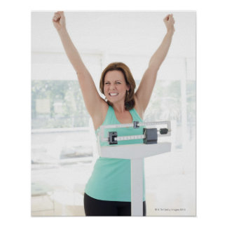 Successful weight loss. Happy woman weighing Poster