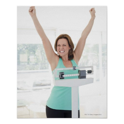 Successful weight loss. Happy woman weighing Print