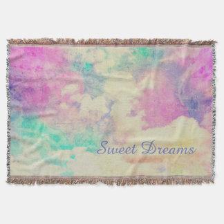 Sueños dulces en nubes coloridas manta