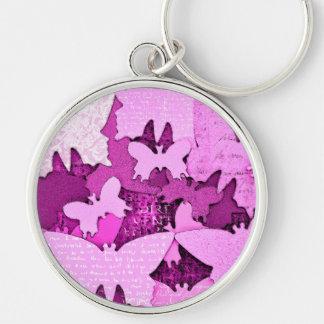 Sueños rosados de la mariposa llavero redondo plateado