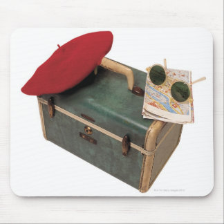 Suitcase , beret , map , and sunglasses mouse pad