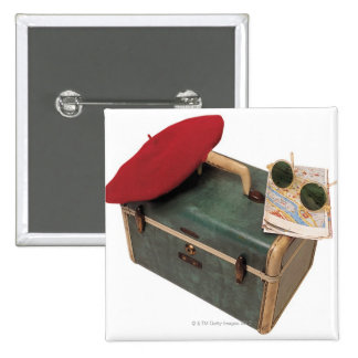 Suitcase , beret , map , and sunglasses pinback button
