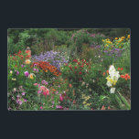 """Summer Flower Garden Laminated Placemat<br><div class=""""desc"""">This artistic floral laminated placemat is a celebration of summer in the flower garden. A scarecrow overlooks pink sweet peas, yellow sunflowers, purple ageratum, pink dahlias, orange brown rudbeckias, plus nicotiana, zinnias and nasturtiums in a rainbow of colors. All are surrounded by lovely green foliage. What a great idea for...</div>"""
