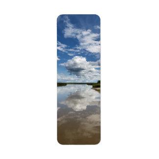 Summer landscape: clouds reflection in river label