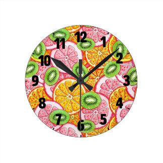 Summer pattern. Orange grapefruit and kiwi fruit. Round Clock