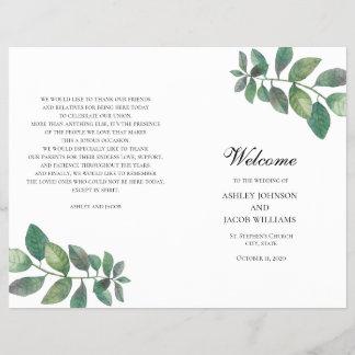 Summer wedding program folded. Green leaves