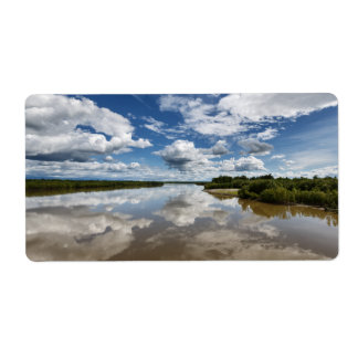 Summery landscape: clouds reflection in river label
