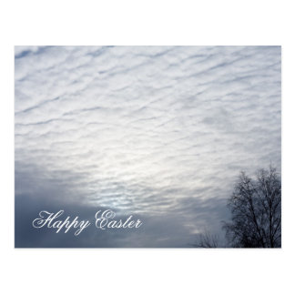 Sun behind clouds happy easter postcard