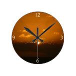 Sun Behind Clouds I Orange Seascape Round Clock
