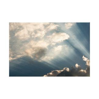 Sun casting beams trough the clouds canvas print