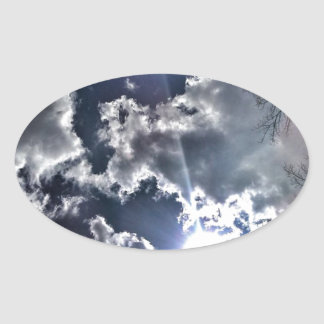 SUN COMING THROUGH THE CLOUDS OVAL STICKER