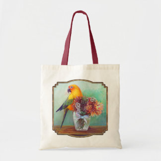 Sun conure and flowers tote bag
