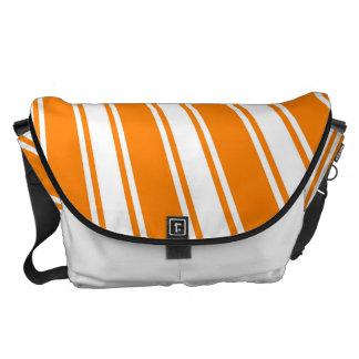 Sun enrrollado anaranjado retro irradia el fondo bolsas messenger
