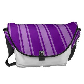 Sun enrrollado púrpura retro irradia el fondo bolsas de mensajeria