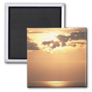 Sun goes down on the ocean magnet