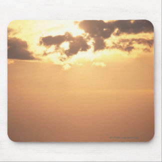 Sun goes down on the ocean mouse pad