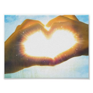 spiritual love symbolized by sun light shining through fingers that form a heart shape poster print pic