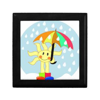 Sun lindo debajo del paraguas durante la lluvia caja de recuerdo