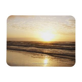 Sun on horizon over ocean magnet