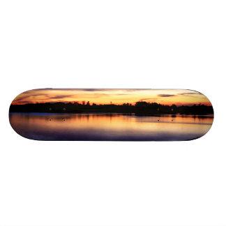 Sun putting in the lagoon of the Dew, Doñana Skateboard