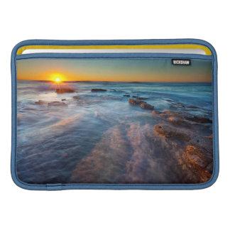 Sun rays illuminate the Pacific Ocean MacBook Sleeves