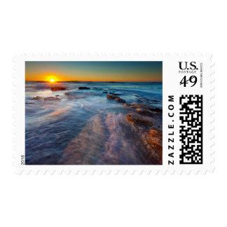 Sun rays illuminate the Pacific Ocean Postage Stamp