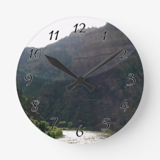Sun Rays Kiss the sky over the mountains & stream Round Clock