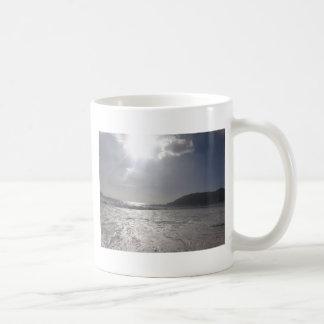 sun reflecting on waves coffee mug