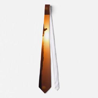 Sun sets behind surfer neck tie
