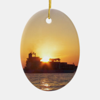 Sun Setting Behind A Container Ship Ceramic Oval Decoration