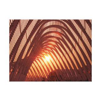 Sun Setting Behind Bridge Canvas Print