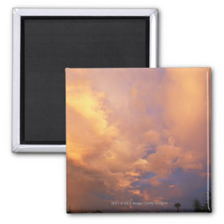 Sun setting behind clouds magnet