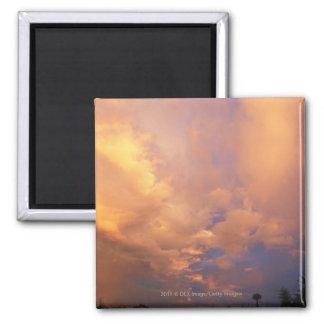 Sun setting behind clouds fridge magnet