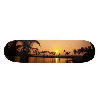 Sun setting on Anaeho'omalu Bay, Big Island, Skate Board