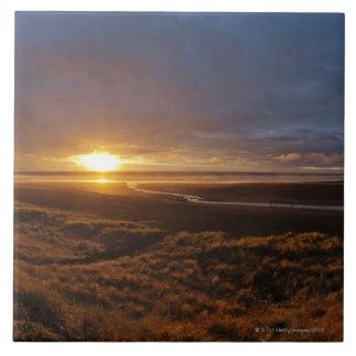 Sun setting over Tasman Sea and Piha Beach, West Ceramic Tile