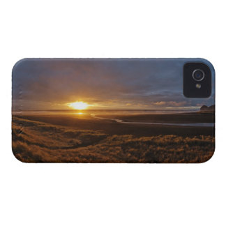 Sun setting over Tasman Sea and Piha Beach, West iPhone 4 Cover