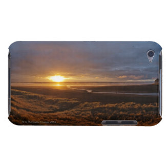 Sun setting over Tasman Sea and Piha Beach, West iPod Case-Mate Case
