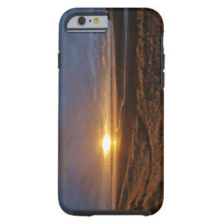 Sun setting over Tasman Sea and Piha Beach, West Tough iPhone 6 Case