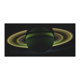 Sun Shining Behind Planet Saturn Casting a Shadow Canvas Print