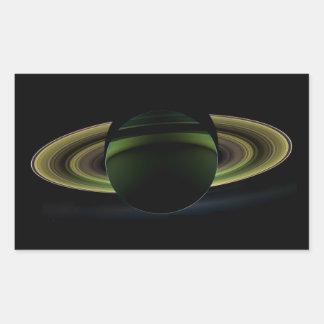 Sun Shining Behind Planet Saturn Casting a Shadow Rectangular Sticker