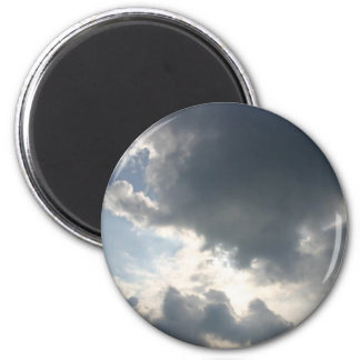 Sun shining through the clouds magnet