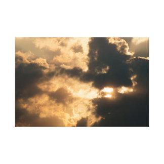 Sun shining trough a beautiful cloudscape canvas print